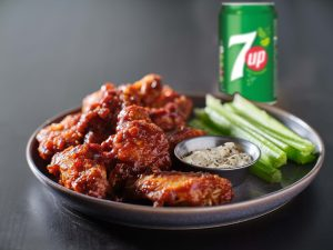 Sweet & Spicy 7UP chicken wings accompanied by celery sticks and mayo