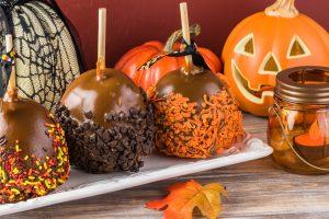Gourmet caramel apples and Halloween decoration.