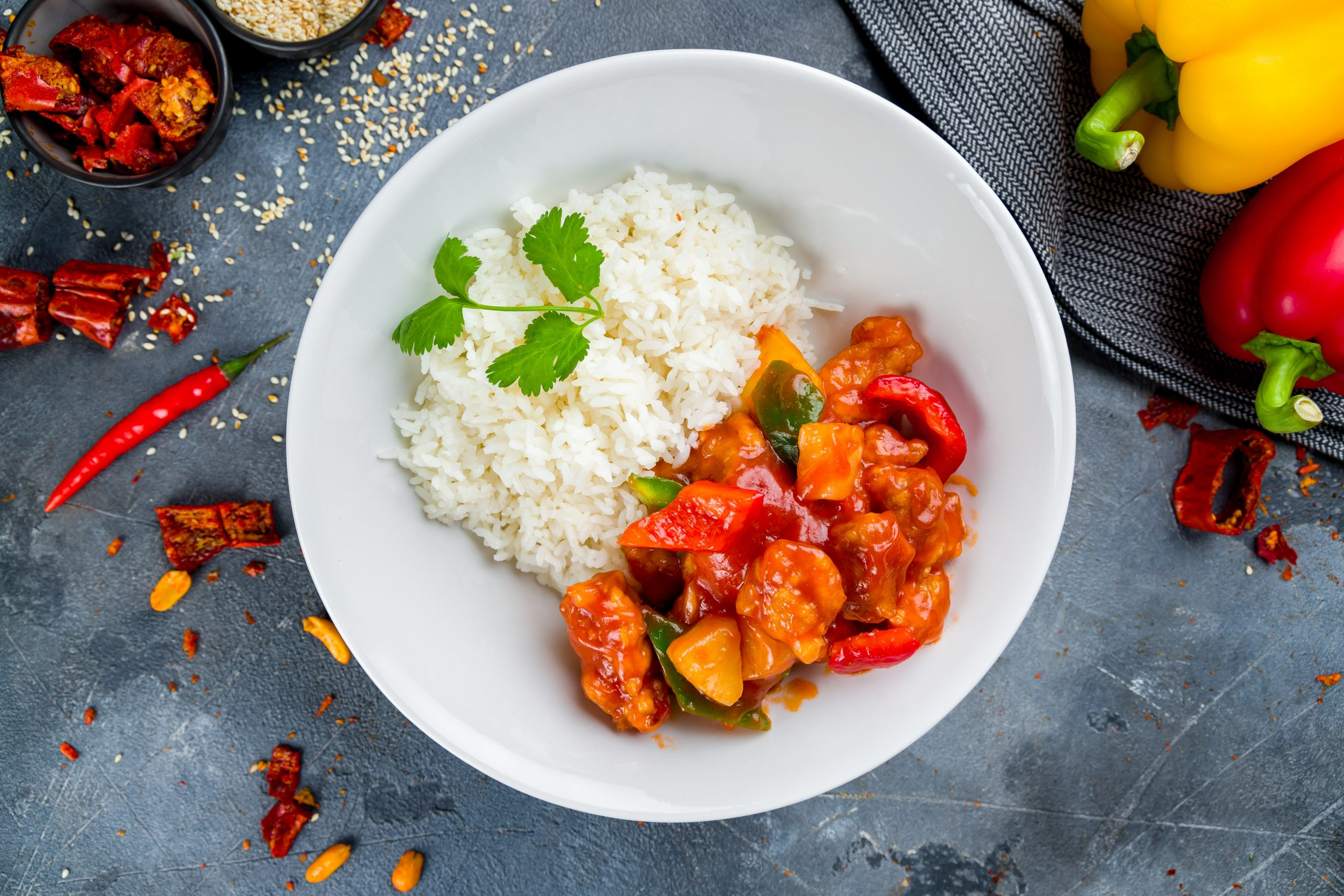 chicken in sweet and sour sauce with rice, chinese cuisine